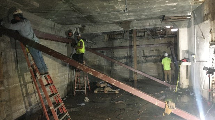 workers framing support beams